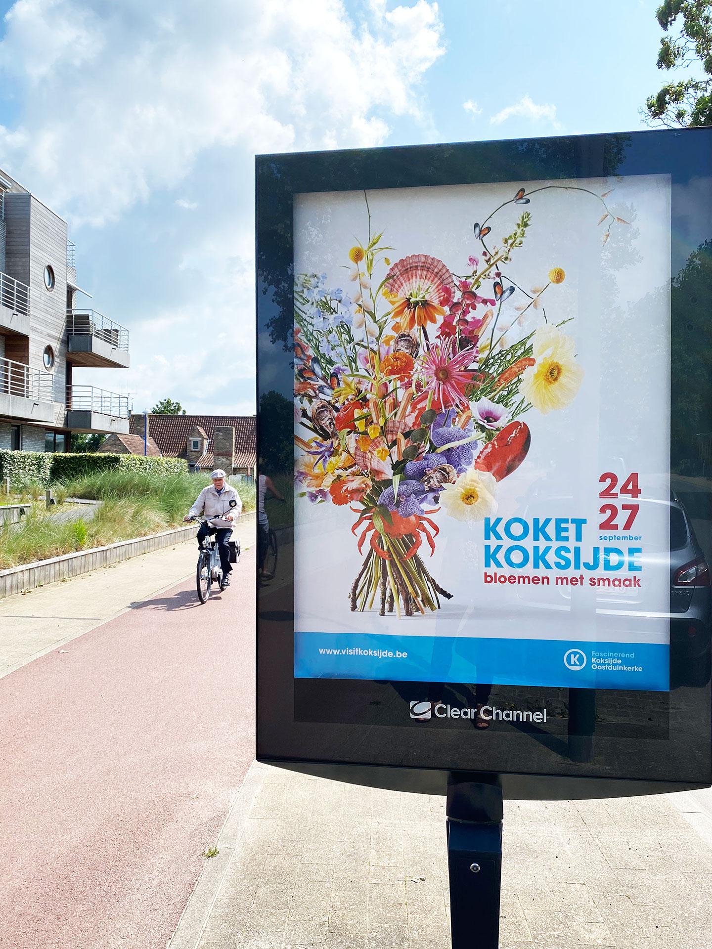Een scherm met het campagnebeeld van Koket Koksijde